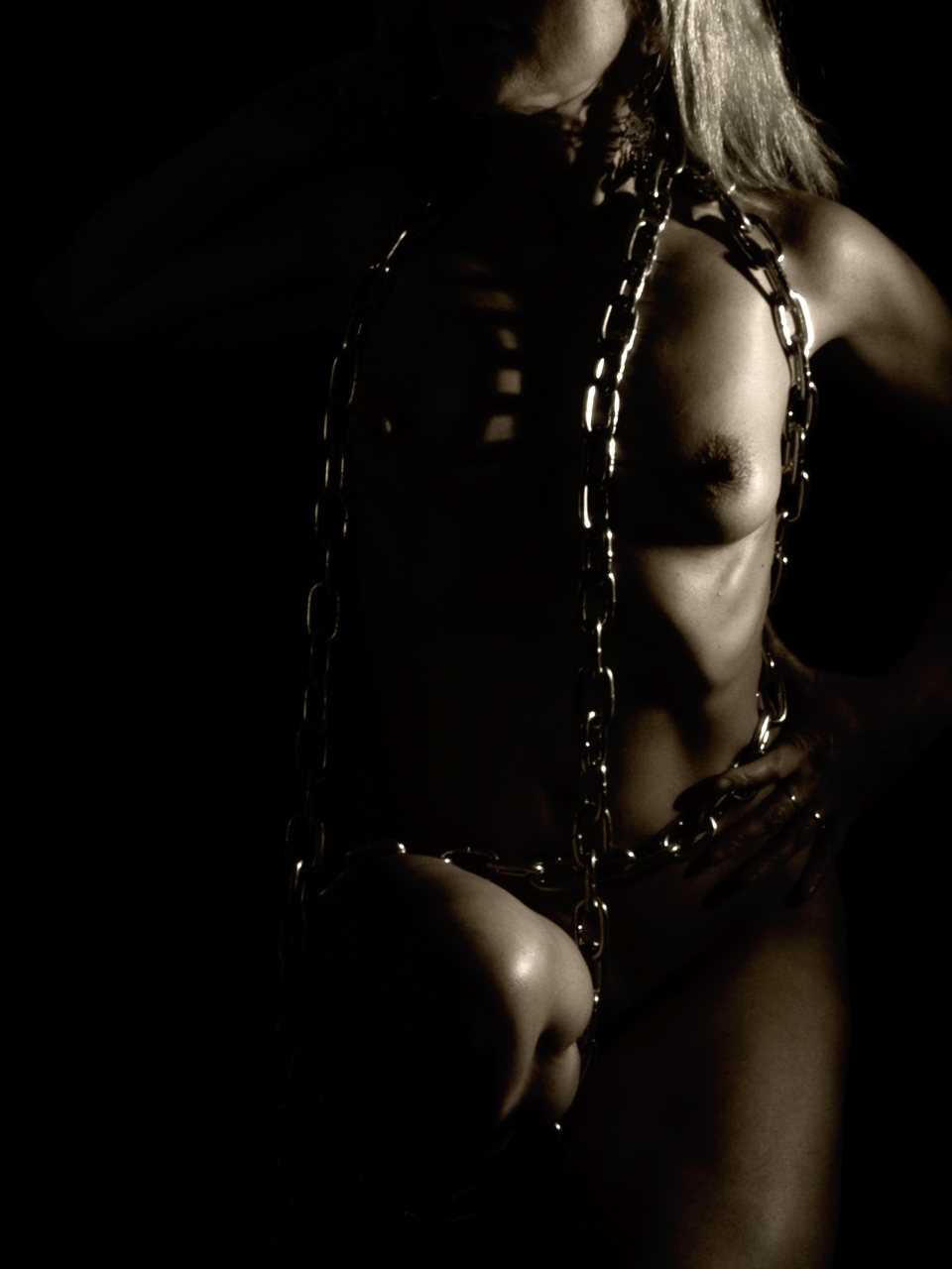 female naked form, chained, deep shadows, crouched