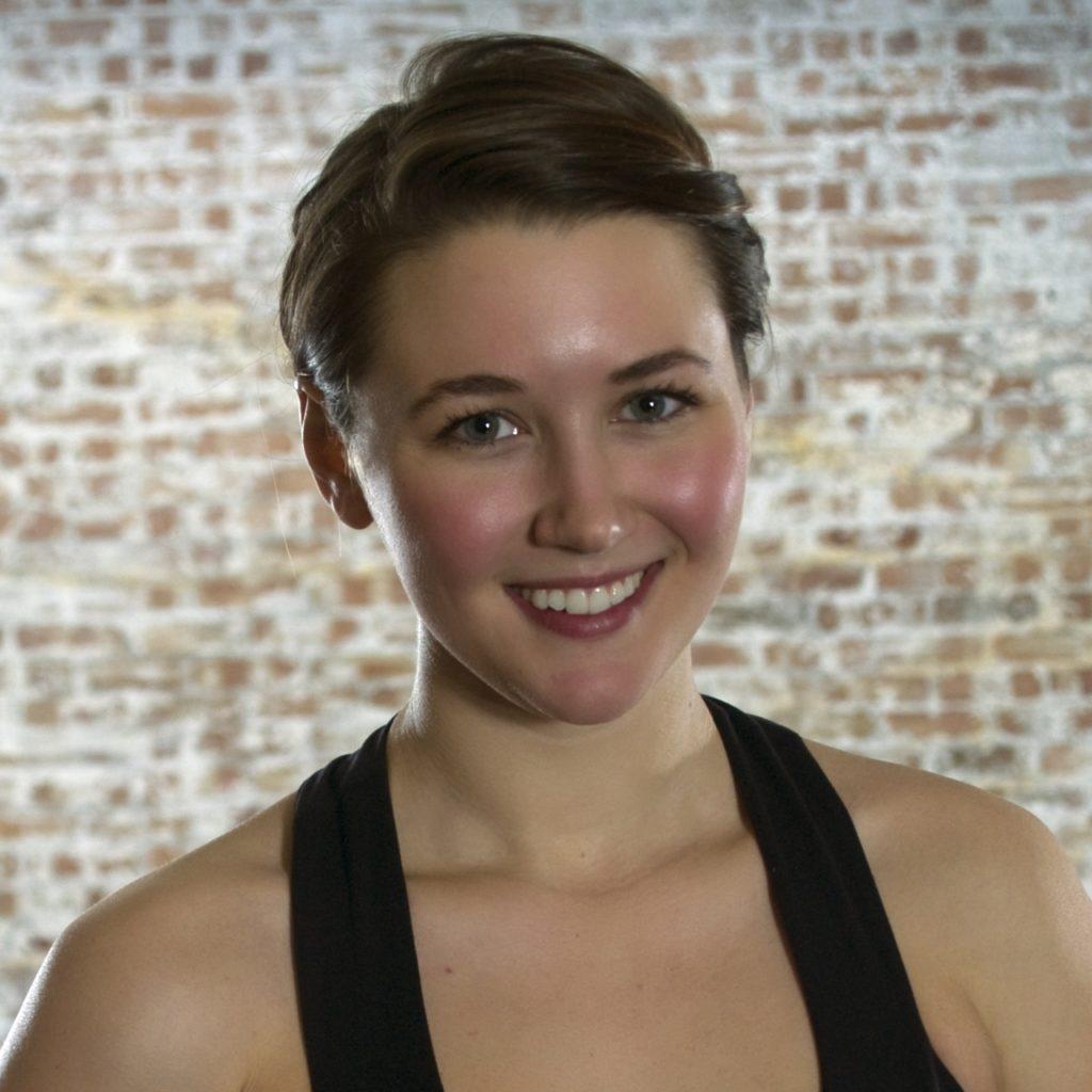 Female dancer smiling, colour