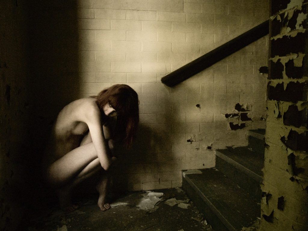 female model, naked on derelict stairway
