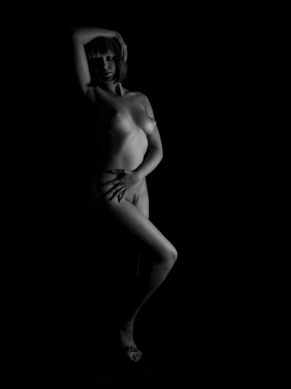 standing female figure model, hands poised