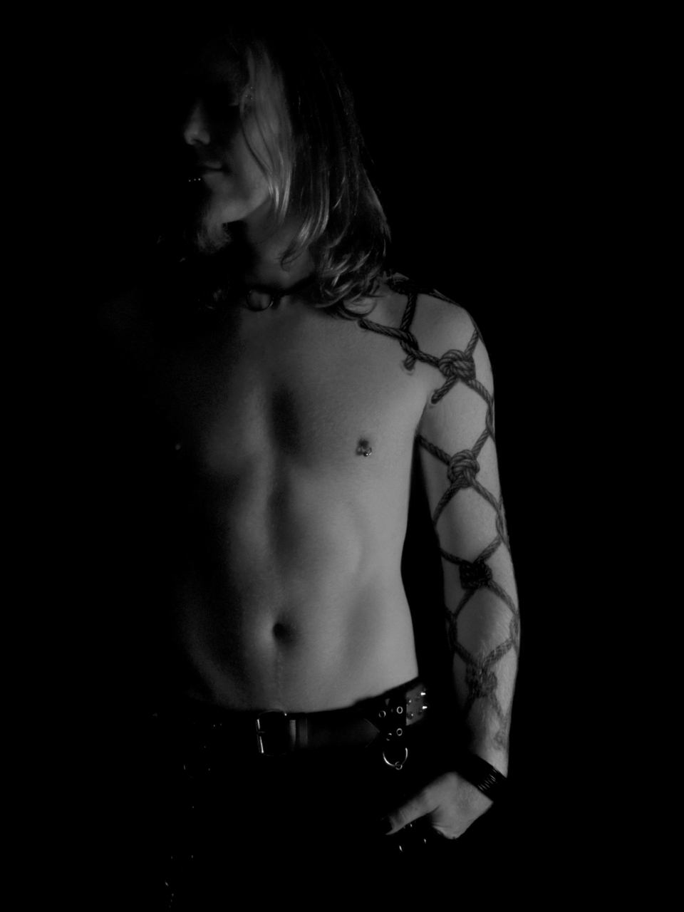 male model, tattoo arm, topless, toned, long hair