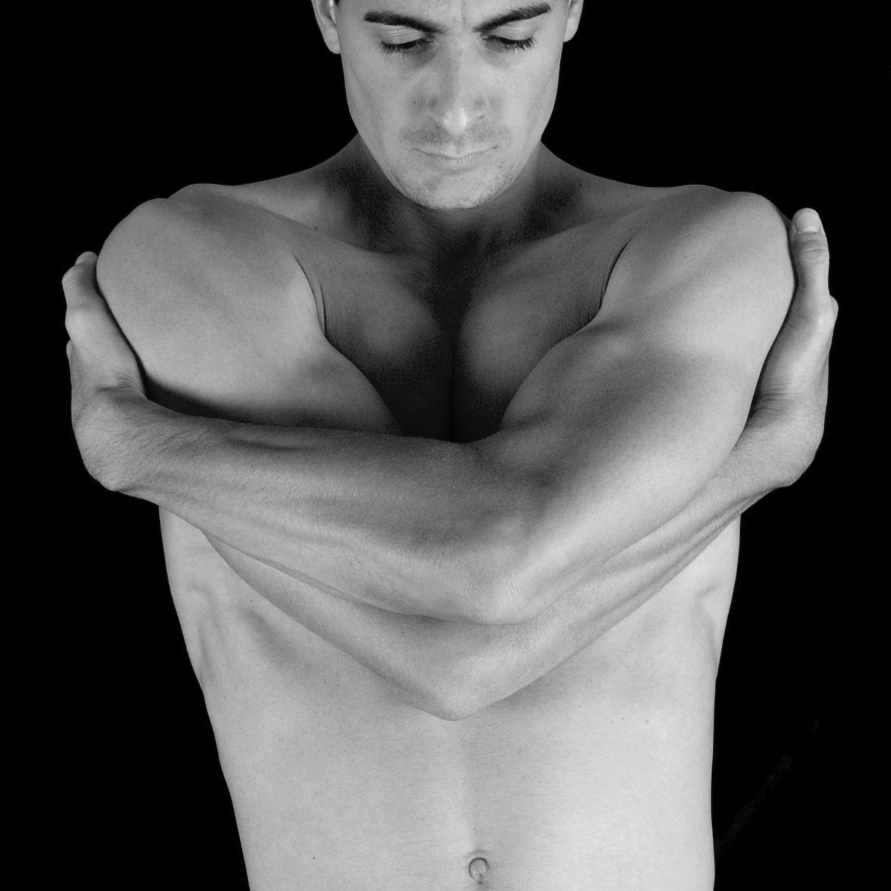 male model, topless hugging self, symmetry